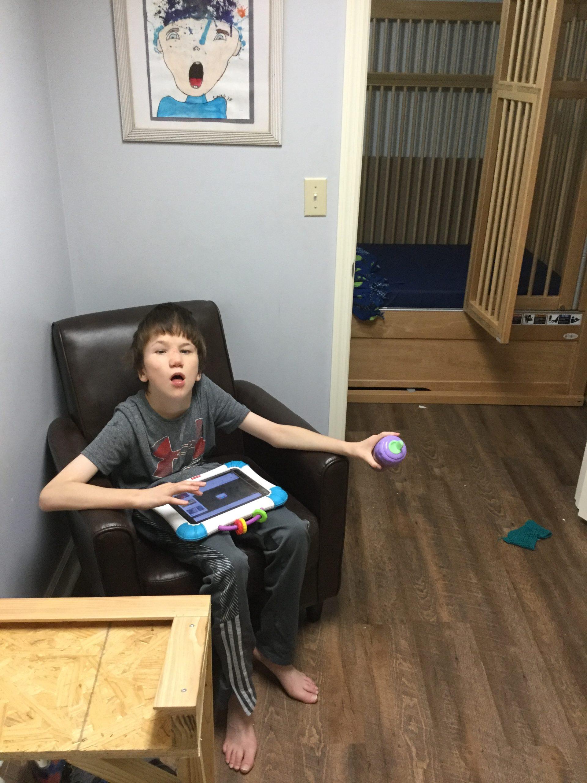 Luke at home with iPad