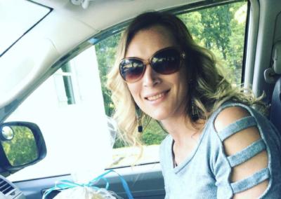 Jess in car with spa basket